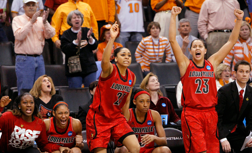 . Louisville\'s bench, including Bria Smith (21) and Shoni Schimmel (23), celebrates the winning free throws against Baylor during the second half of a regional semifinal in the women\'s NCAA college basketball tournament in Oklahoma City, Sunday, March 31, 2013. Louisville won 82-81. (AP Photo/Alonzo Adams)