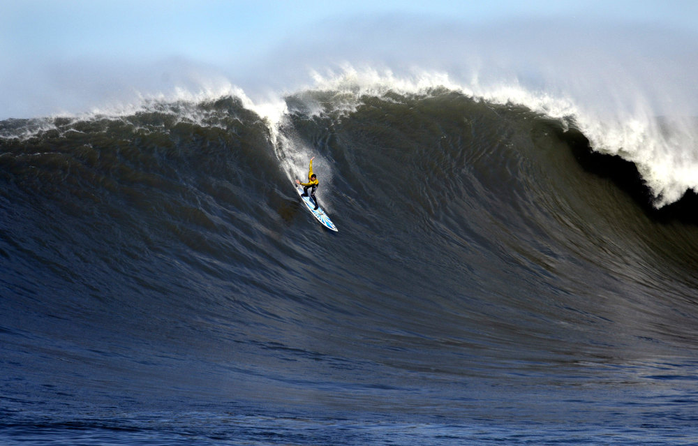 Description of . Kenny 'Skindog' Collins rockets down the wave face in the 3rd heat of the 2010 Mavericks contest.  (Dan Coyro/Sentinel)