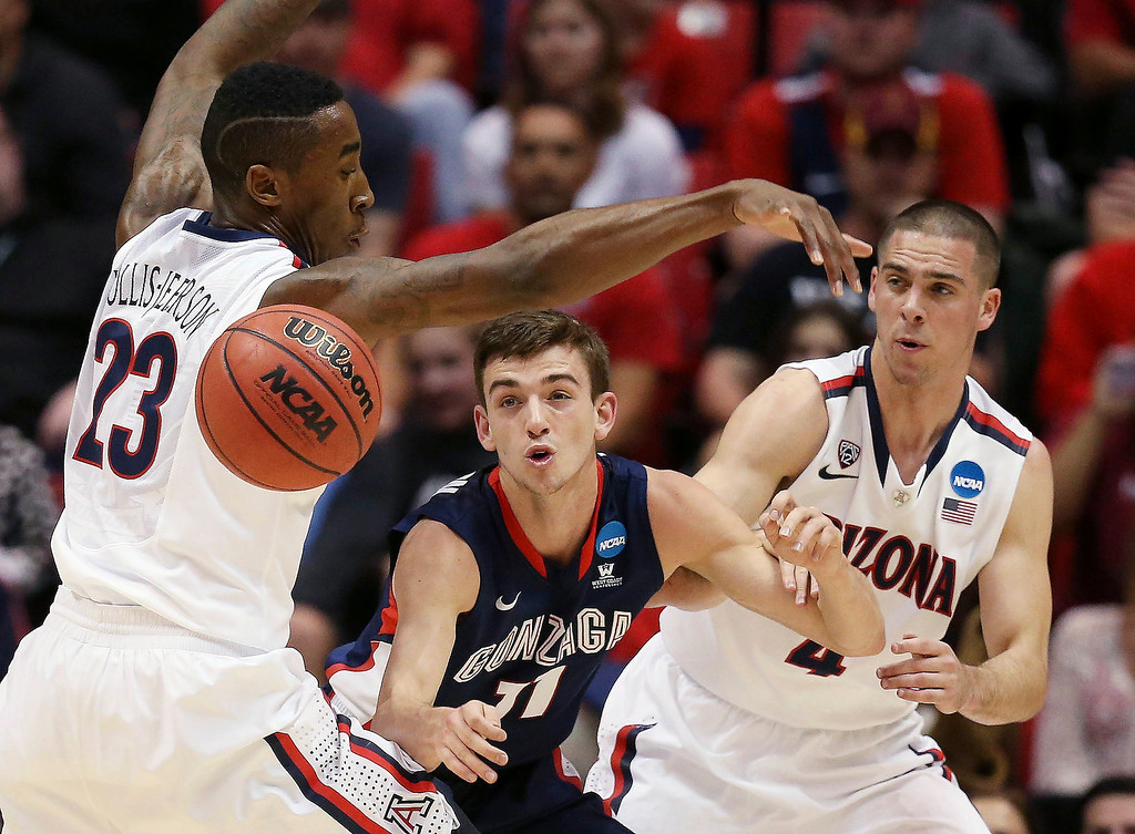 . Rondae Hollis-Jefferson #23 and T.J. McConnell #4 of the Arizona Wildcats defend against David Stockton #11 of the Gonzaga Bulldogs in the first half during the third round of the 2014 NCAA Men\'s Basketball Tournament at Viejas Arena on March 23, 2014 in San Diego, California.  (Photo by Jeff Gross/Getty Images)