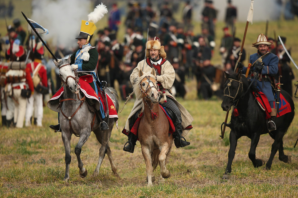 . Historical society enthusiasts in the role of troops fighting Napoleon, including two playing Bishkirian horsemen (C and R), advance on the enemy during the re-enactment of The Battle of Nations on its 200th anniversary on October 20, 2013 near Leipzig, Germany. (Photo by Sean Gallup/Getty Images)