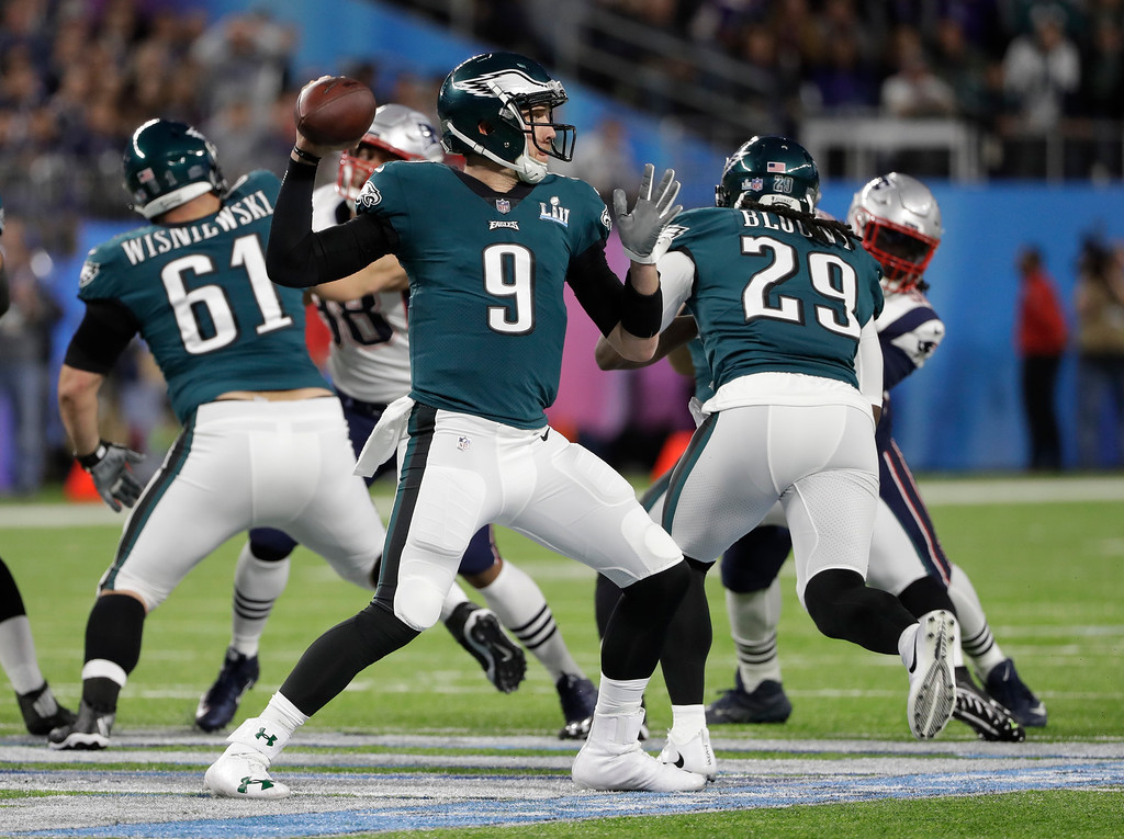 . Philadelphia Eagles quarterback Nick Foles (9,) throws against the New England Patriots during the first half of the NFL Super Bowl 52 football game, Sunday, Feb. 4, 2018, in Minneapolis. (AP Photo/Chris O\'Meara)