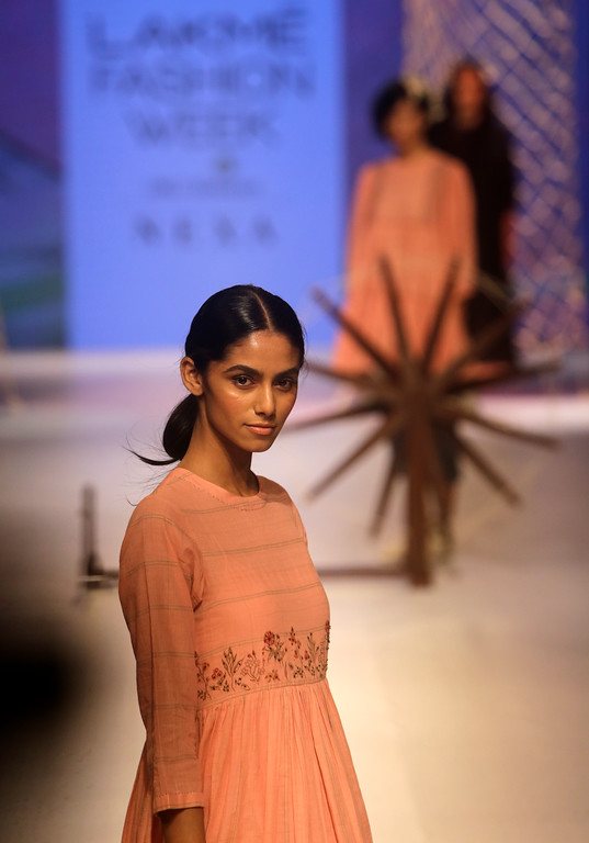 . A model walks the ramp to showcase the creation of designer Lars Andersson during Lakme fashion week winter 2018 in Mumbai, India, Thursday, Aug. 23, 2018. (AP Photo/Rajanish Kakade)
