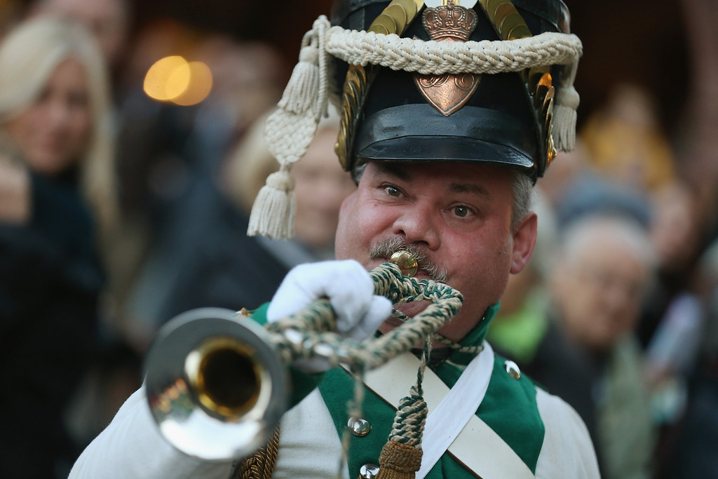 . An actor in the role of a Napoleonic soldier blows a trumpet to announce the arrival of Napoleon Bonaparte at the evening opening ceremony to commemorate the 200th anniversary of The Battle of Nations on October 16, 2013 in Leipzig, Germany.  (Photo by Sean Gallup/Getty Images)