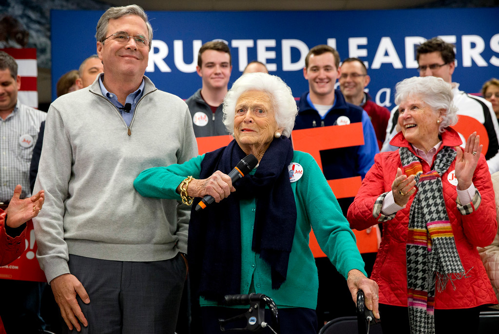 . Barbara Bush, center, jokes with her son, Republican presidential candidate, former Florida Gov. Jeb Bush, while introducing him at a town hall meeting at West Running Brook Middle School in Derry, N.H., Thursday Feb. 4, 2016. (AP Photo/Jacquelyn Martin)