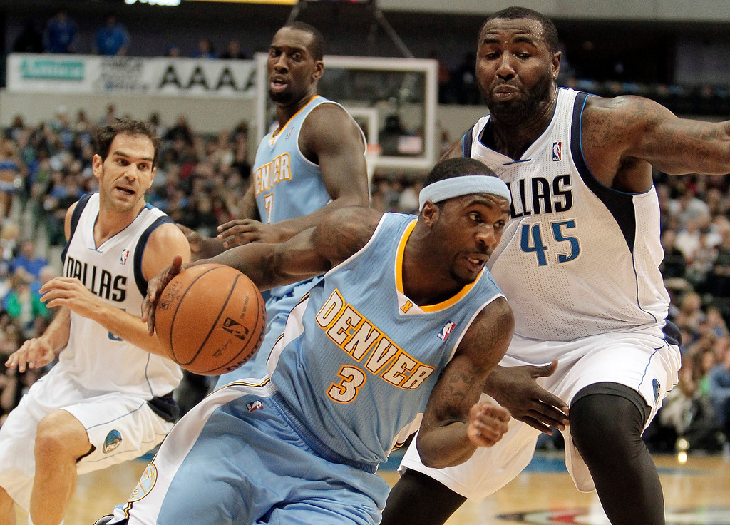 . Denver Nuggets guard Ty Lawson (3) looks to get around Dallas Mavericks\' DeJuan Blair (45) during the first half of an NBA basketball game Monday, Nov. 25, 2013, in Dallas. (AP Photo/Brandon Wade)