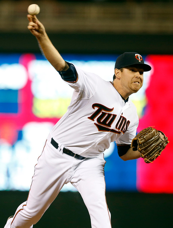 . Minnesota Twins pitcher Tim Stauffer throws in relief against the Detroit Tigers in the fifth inning of a baseball game, Monday, April 27, 2015, in Minneapolis. (AP Photo/Jim Mone)