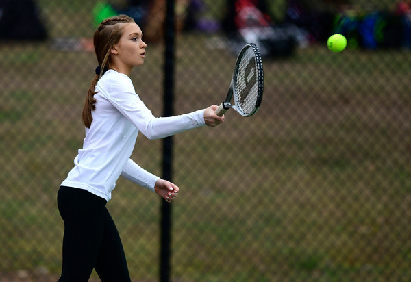 4/18/2019 Mike Orazzi | Staff St. Paul's Carina Fiscella during Thursday's girls tennis match with Naugatuck in Bristol's Page Park.