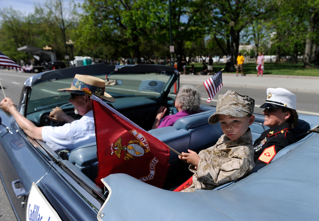 . Riding down Broadway with the Women Marines Association is Sgt. Maj. Pam Talluto and her son Tristan.  (Photo By Kathryn Scott Osler/The Denver Post)