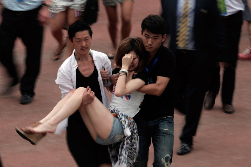 . A fan got injured in a stampede during David Beckham\'s visit at Tongji University on June 20, 2013 in Shanghai, China. (Photo by Lintao Zhang/Getty Images)
