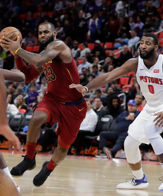 . Cleveland Cavaliers forward LeBron James (23) drives around Detroit Pistons center Andre Drummond (0) during the second half of an NBA basketball game, Monday, Nov. 20, 2017, in Detroit. (AP Photo/Carlos Osorio)
