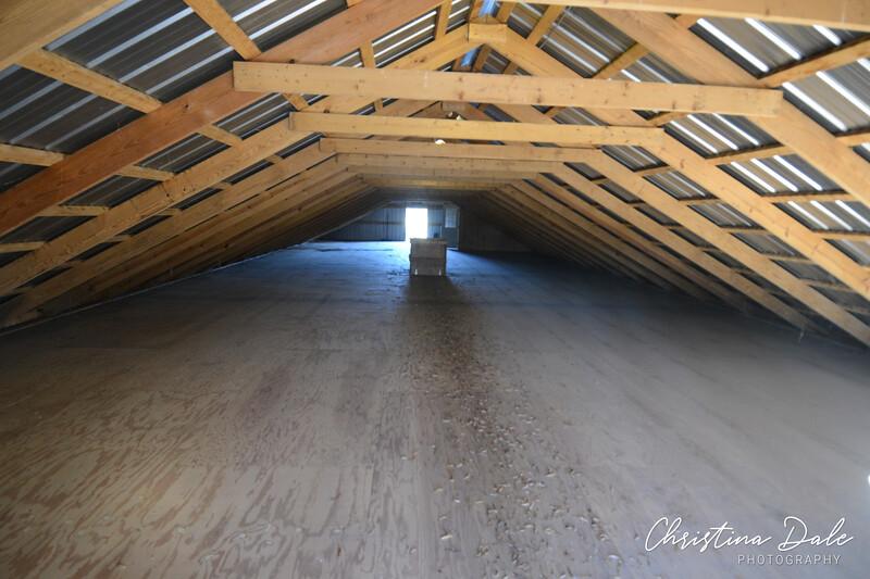 Hay loft, doors at both ends. Door to stairs (feed room) and drop door in middle of floor.
