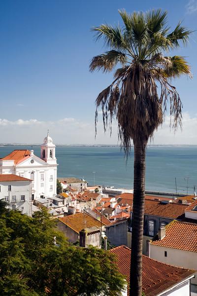 View of Lisbon from Santa Luzia viewpoint, Portugal. Santo Estevao church on the left.