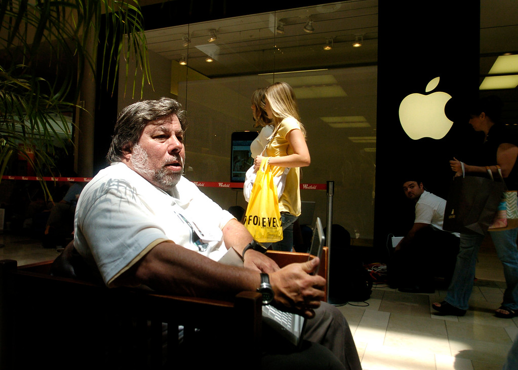 . Apple, Inc. co-founder Steve Wozniak waits outside a Santa Clara, Calif., Apple retail store to buy an iPhone on Friday, June 29, 2007. Wearing an iPhone shirt created by friends, Woziak arrived around 4 a.m. to await the first sales of the phone at 6 p.m. local time. (AP Photo/Noah Berger)