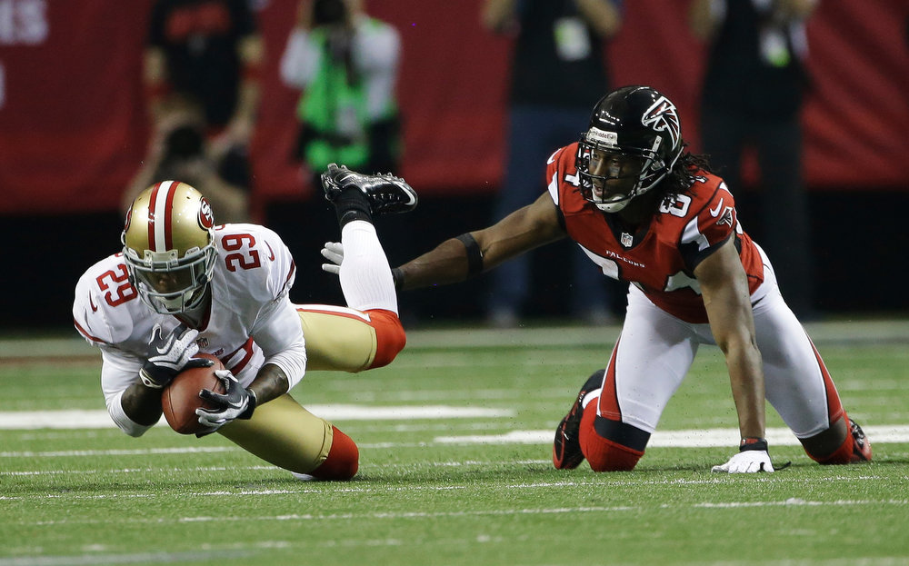 . San Francisco 49ers\' Chris Culliver (29) intercepts a pass in front of Atlanta Falcons\' Roddy White during the second half of the NFL football NFC Championship game Sunday, Jan. 20, 2013, in Atlanta. (AP Photo/Mark Humphrey)