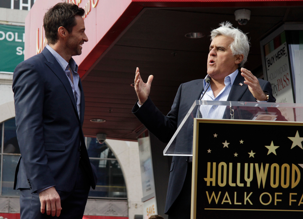 Description of . Television host Jay Leno (R) introduces actor Hugh Jackman during ceremonies honoring Jackman with a star on the Hollywood Walk of Fame in Hollywood, California, December 13, 2012. REUTERS/Jonathan Alcorn