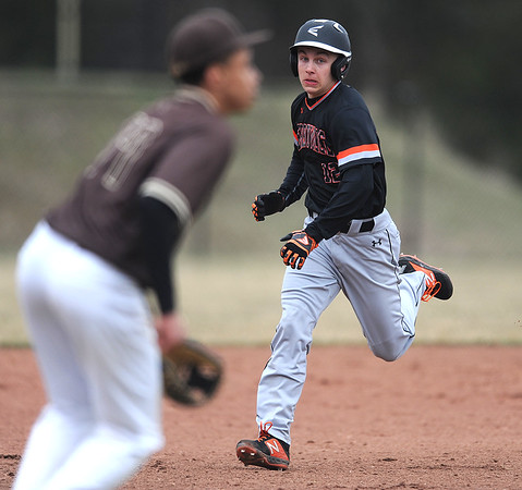 4/11/2019 Mike Orazzi | Staff Terryville's Colby Rheault (12) on his way to third base during Thursday's baseball game at Terryville High School.