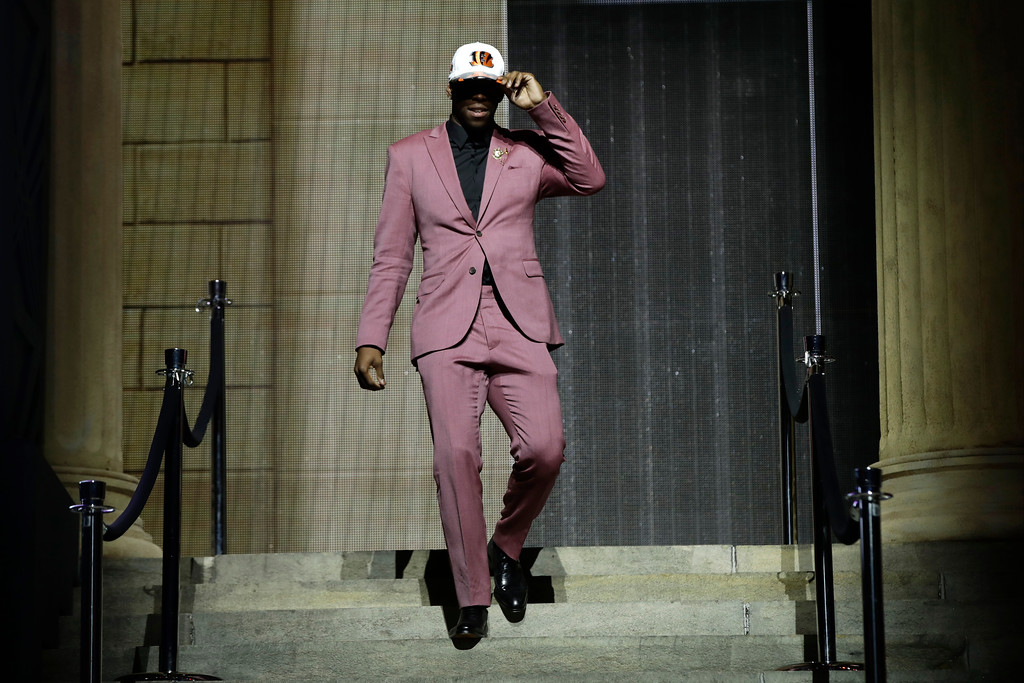 . Washington\'s John Ross reacts after being selected by the Cincinnati Bengals during the first round of the 2017 NFL football draft, Thursday, April 27, 2017, in Philadelphia. (AP Photo/Matt Rourke)