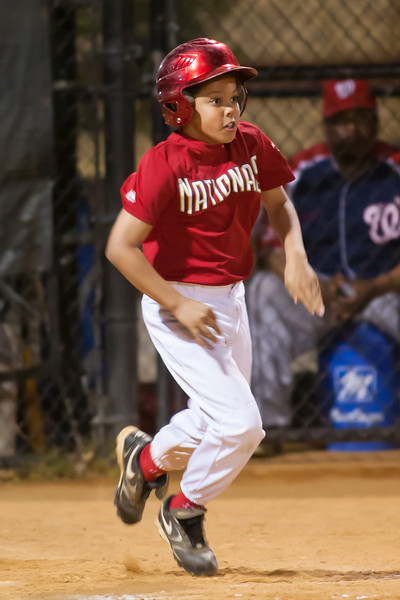 Isaiah gets a sacrifice RBI and is thrown out at 1st base to extend the Nats lead to 10-0 in the bottom of the 5th inning. The Nationals won their second game in a row to start the season with an 11-0 victory over the Twins. 2012 Arlington Little League Baseball, Majors Division. Nationals vs Twins (19 Apr 2012) (Image taken by Patrick R. Kane on 19 Apr 2012 with Canon EOS-1D Mark III at ISO 3200, f2.8, 1/250 sec and 300mm)