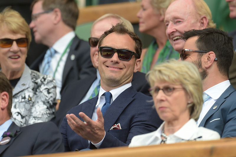 . British actor Jude Law sits in the Royal box on Centre Court during the men\'s singles semi-final match between Switzerland\'s Roger Federer and Canada\'s Milos Raonic during their on day 11 of the 2014 Wimbledon Championships at The All England Tennis Club in Wimbledon, southwest London, on July 4, 2014. (FACUNDO ARRIZABALAGA/AFP/Getty Images)