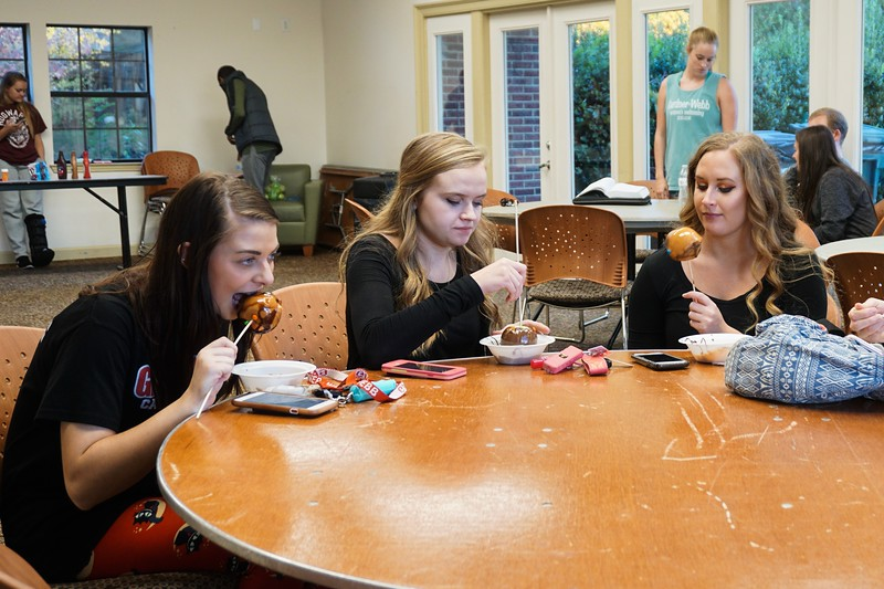Haley Lingle, Bonnie Belcher, and Taylor Auton enjoy their apples together.