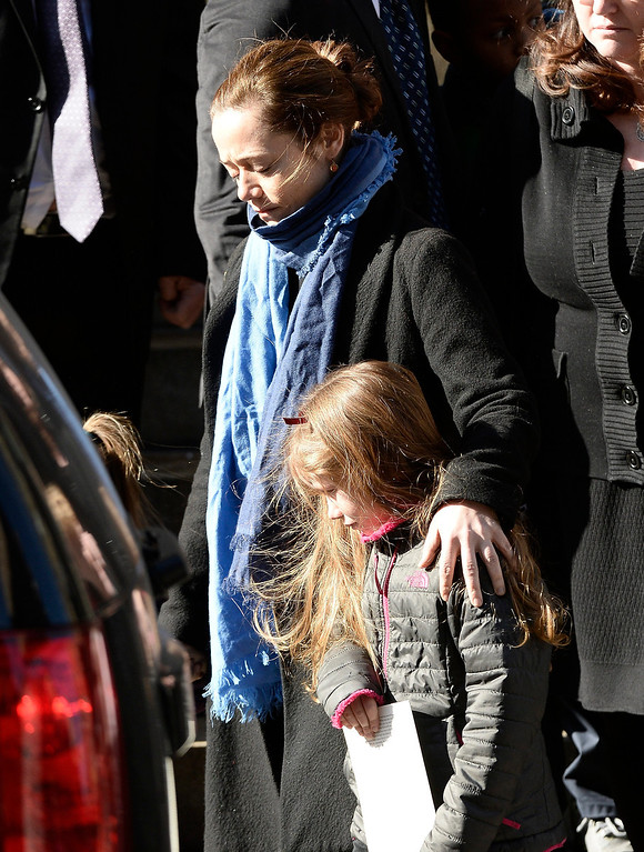 . Long time girlfriend of US actor Phillip Seymour Hoffman, Mimi O\'Donnel (L) with their daughter Willa (R) leave the Funeral Mass for Hoffman at St Ignatius Church in New York, New York, USA 07 February 2014. Hoffman, 46, died 02 February from a suspected drug overdose.  EPA/ANDREW GOMBERT