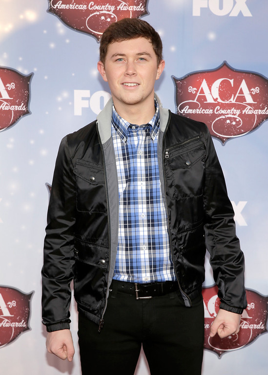 . Recording artist Scotty McCreery arrives at the 2013 American Country Awards at the Mandalay Bay Events Center on December 10, 2013 in Las Vegas, Nevada.  (Photo by Isaac Brekken/Getty Images)