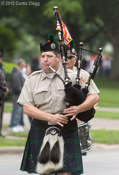 Bagpiper Eric Blanken of DeKalb with DeKalb Fire's Highland Honor Guard at the Ellwood House in DeKalb, Ill. during a Memorial Day observance on Monday, May 27, 2013.