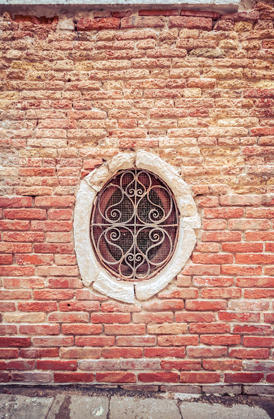 Wrought Iron Window in an Ancient Brick Wall, Venice, Italy