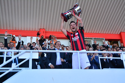 Lincoln Red Imps captain recieves Rock Cup From Michel Platini and celebrates at the Victoria Stadium, Gibraltar.