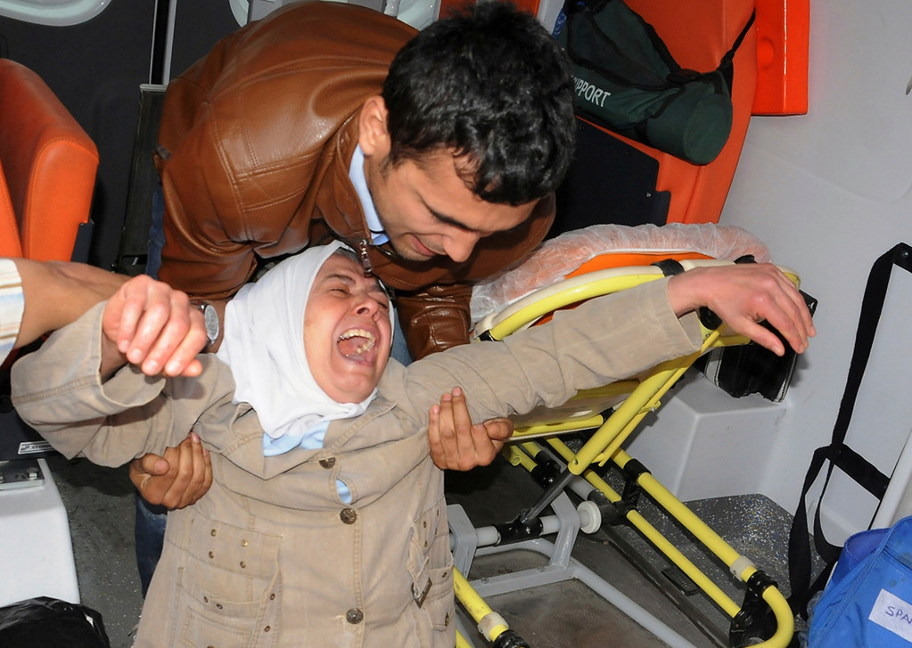 . A woman reacts after seeing the dead body of a relative outside a coal mine in Soma, western Turkey, some 250 kilometers (155 miles) south of Istanbul, early Wednesday, May 14, 2014.  (AP Photo/Depo Photos)
