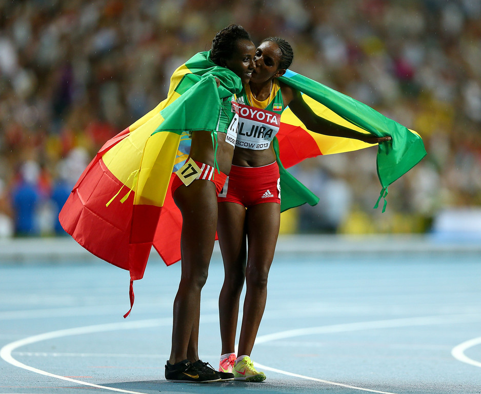 . (L-R) Gold medalist Tirunesh Dibaba of Ethiopia and bronze medalist Belaynesh Oljira of Ethiopia celebrate after the Women\'s 10000 final during Day Two of the 14th IAAF World Athletics Championships Moscow 2013 at Luzhniki Stadium on August 11, 2013 in Moscow, Russia.  (Photo by Paul Gilham/Getty Images)
