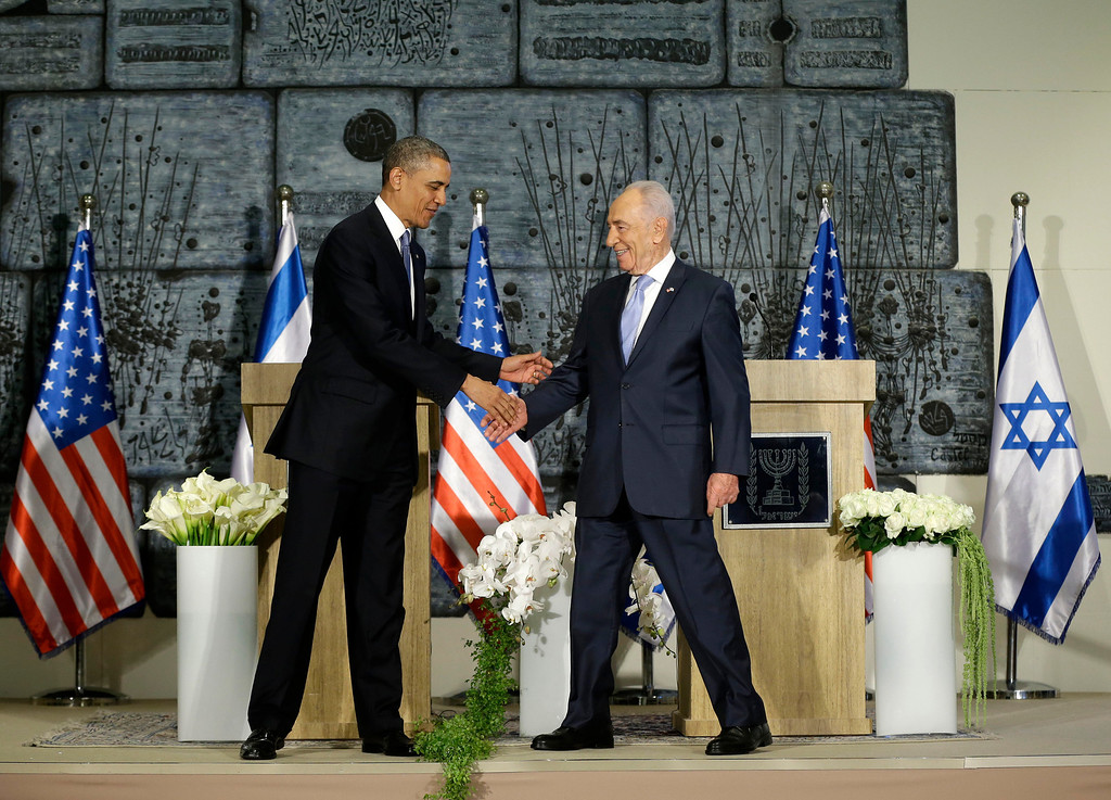 . President Barack Obama and Israeli President Shimon Peres shake hands following their joint statement to members of the media at the President\'s Residence in Jerusalem, Israel, Wednesday, March 20, 2013, (AP Photo/Pablo Martinez Monsivais)