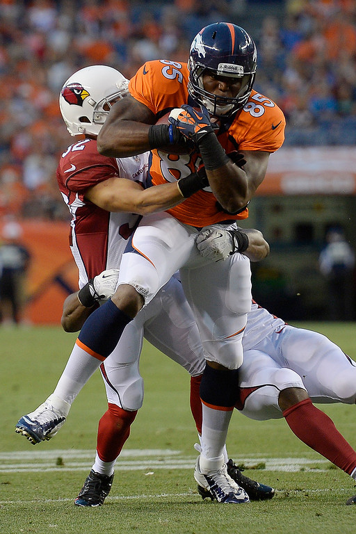 . Arizona Cardinals defensive back Tyrann Mathieu (32) tackles Denver Broncos tight end Virgil Green (85) during the third quarter on August 29, 2013 at Sports Authority Field at Mile High. The Denver Broncos hosted the Arizona Cardinals in the final game of the preseason. (Photo by John Leyba/The Denver Post)