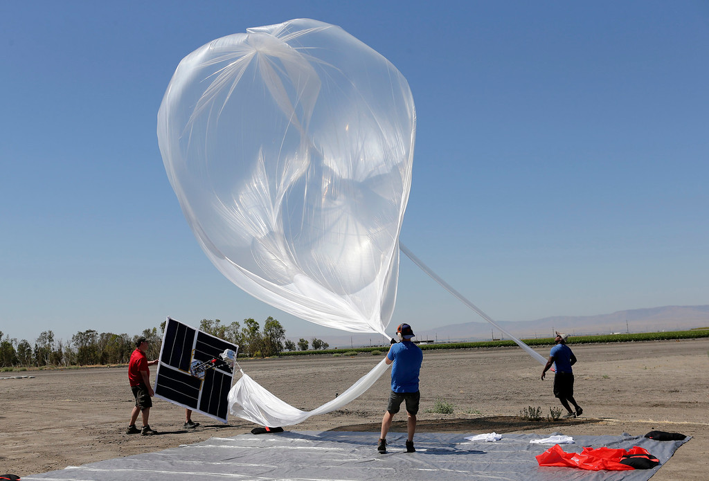 . The Project Loon team from Google launch a high-altitude balloon carrying electronic testing equipment into the skies above Dos Palos, Calif. on Friday, July 26, 2013. The test launch is part of the research being done by the Google X division to create a high-altitude transponder network that will provide internet access to underserved areas of the world.  (Gary Reyes/Bay Area News Group)