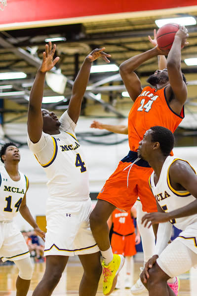 Bright Afful (4) tries to block Hakeem Animashaun's shot (24) in the first half.