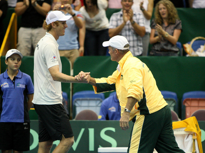 11 April 2008 Townsville, Qld, Australia - Australian captain John Fitzgerald congratulates Chris Guccione on his win over Thailand's Danai Udomchoke in the fist singles rubber of their Davis Cup tie - Photo: Cameron Laird (Ph: 0418 238811)