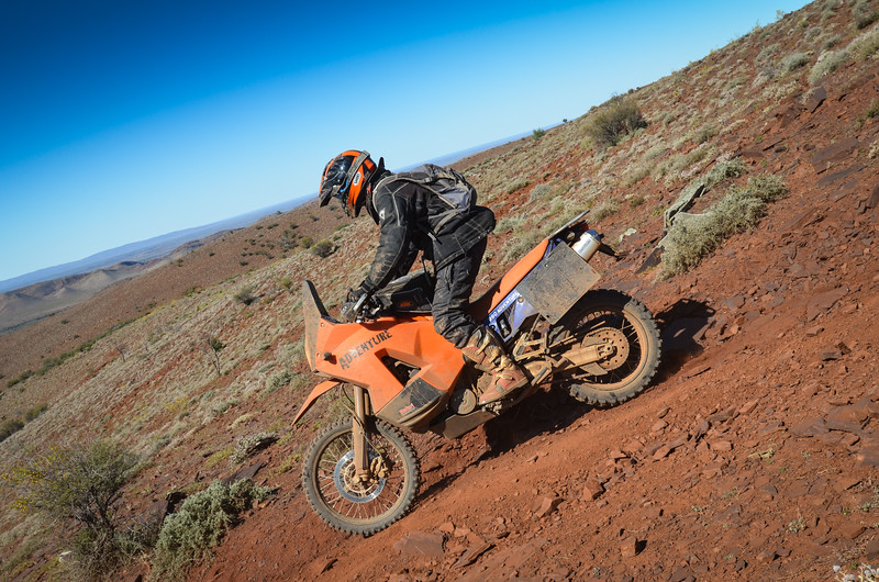 Bob Condon making his way down off a hill top high in the Flinders Ranges near Blinman
