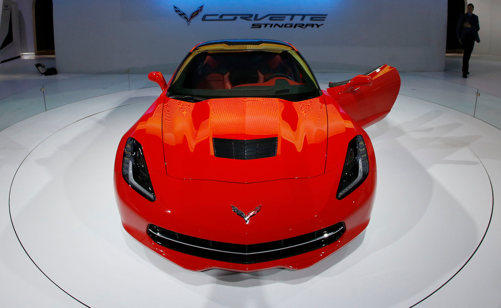 Description of . The 2014 Chevrolet Corvette Stingray is revealed at the Chicago Auto Show Thursday, Feb. 7, 2013, in Chicago. (AP Photo/Charles Rex Arbogast)