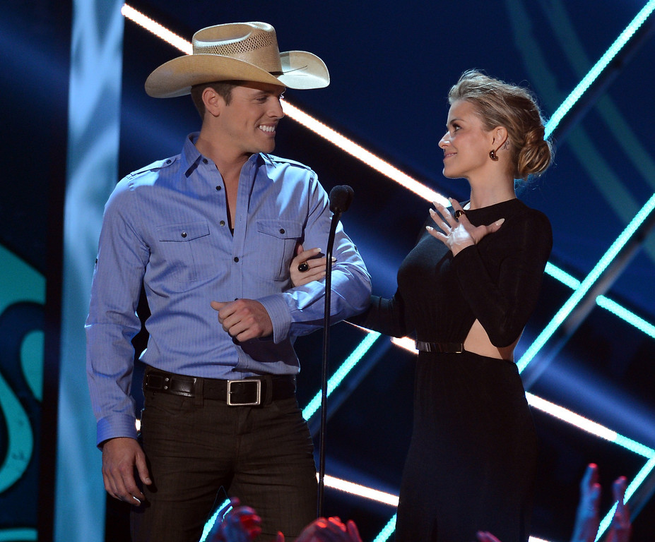 . LAS VEGAS, NV - DECEMBER 10:  (L-R) Presenters Dustin Lynch and Carmen Electra speak onstage during the 2012 American Country Awards at the Mandalay Bay Events Center on December 10, 2012 in Las Vegas, Nevada.  (Photo by Mark Davis/Getty Images)