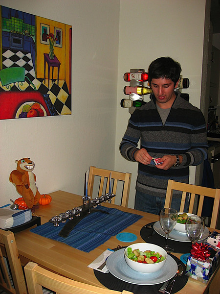 Lighting the candles on the first night of Chanukkah