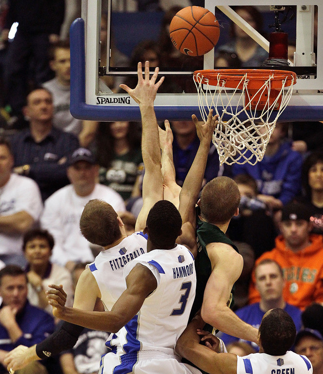 . Colorado State\'s Pierce Hornung, right, shoots as Air Force\'s Mike Fitzgerald, far left, and Justin Hammond, center, try to block during the first half of an NCAA college basketball game in Air Force Academy, Colo., Saturday, Feb. 16, 2013. Colorado State won 89-86. (AP Photo/Brennan Linsley)