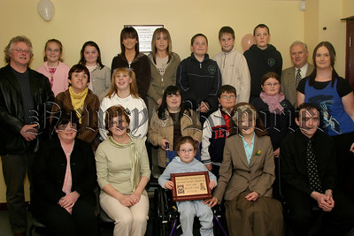 Friends and members of the Buddy Group of the newly formed Mayobridge special needs youth club , with Paul Bradly (youth leader) left, Ron Millar (chairman of club) second from right standing, Mother Attracta who launched the new club, Josephine O'Hare (chairperson), Rita Mc Polin (treasurer) seated left, Fiona Lynch (leader) standing on right, Nial Brady (youth club). 05W13N62.