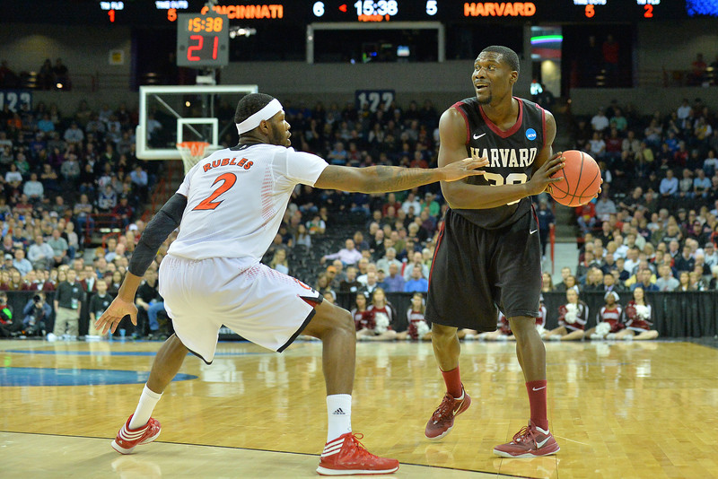 March 20, 2014: Harvard Crimson forward Kyle Casey (30) looks to pass inside during a second round game of the NCAA Division I Men's Basketball Championship between the 5-seed Cincinnati Bearcats and the 12-seed Harvard Crimson at Spokane Arena in Spokane, Wash. Harvard defeated Cincinnati 61-57.
