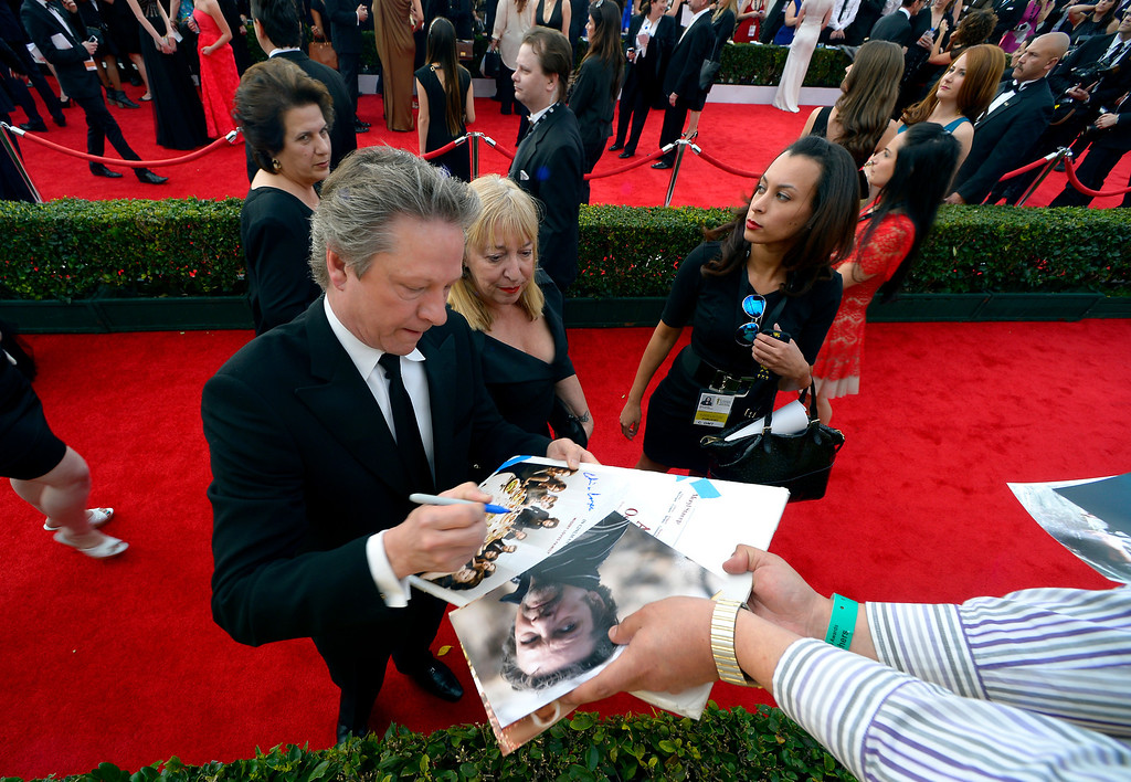 . Chris Cooper signs autographs on the red carpet at the 20th Annual Screen Actors Guild Awards  at the Shrine Auditorium in Los Angeles, California on Saturday January 18, 2014 (Photo by Andy Holzman / Los Angeles Daily News)