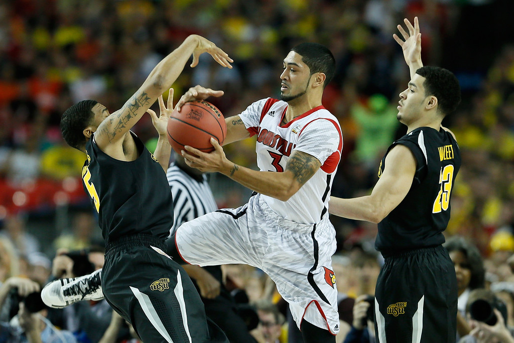 . ATLANTA, GA - APRIL 06:  Peyton Siva #3 of the Louisville Cardinals with the ball between Demetric Williams #5 and Fred VanVleet #23 of the Wichita State Shockers in the first half during the 2013 NCAA Men\'s Final Four Semifinal at the Georgia Dome on April 6, 2013 in Atlanta, Georgia.  (Photo by Kevin C. Cox/Getty Images)