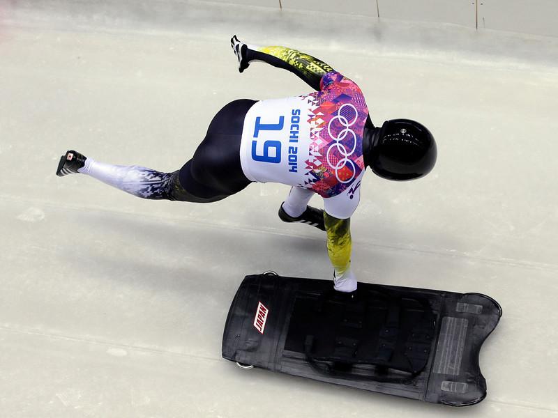 . Yuki Sasahara of Japan starts his first run during the men\'s skeleton competition at the 2014 Winter Olympics, Friday, Feb. 14, 2014, in Krasnaya Polyana, Russia. (AP Photo/Michael Sohn)