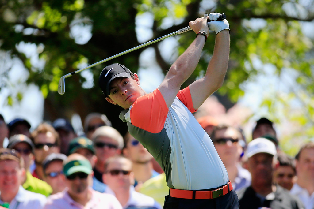 . Rory McIlroy of Northern Ireland watches his tee shot on the fourth hole during the first round of the 2014 Masters Tournament at Augusta National Golf Club on April 10, 2014 in Augusta, Georgia.  (Photo by Rob Carr/Getty Images)