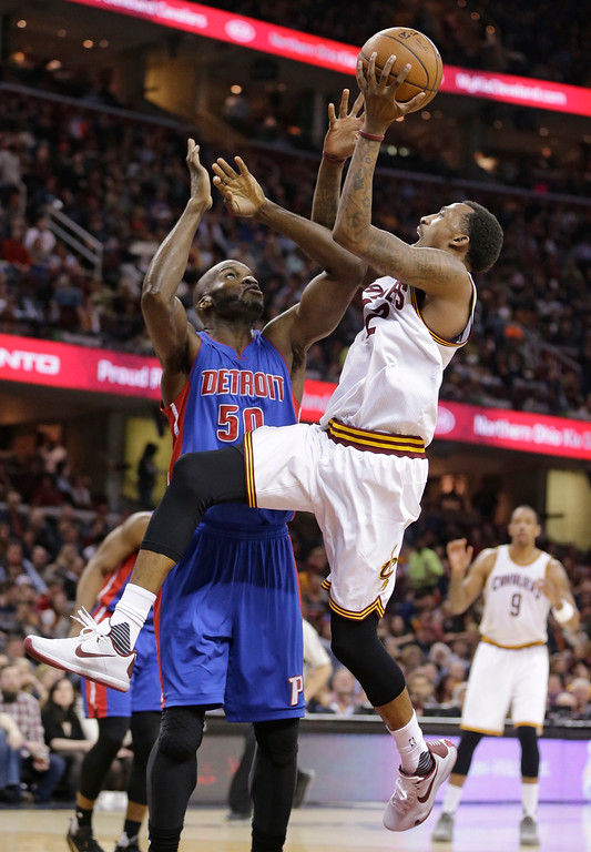 . Cleveland Cavaliers\' Jordan McRae (12) drives to the basket against Detroit Pistons\' Joel Anthony (50) during the first half of an NBA basketball game Wednesday, April 13, 2016, in Cleveland. (AP Photo/Tony Dejak)