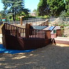 panorama with ships prow and sloping timber deck and spinner and slide and musical element