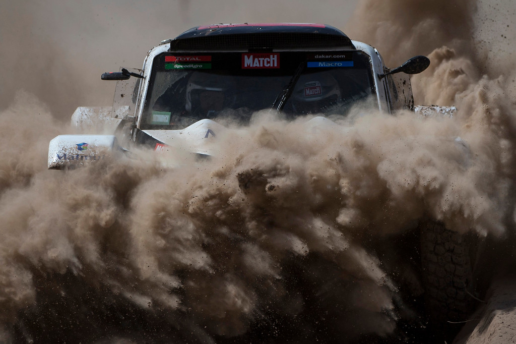 . Buggy MD Rally driver Pascal Thomasse and co-pilot Pascal Larroque, both of France, race during the third stage of the Dakar Rally 2015 between the cities of San Juan and Chilecito, Argentina, Tuesday, Jan. 6, 2015. The race will finish on Jan. 17, passing through Bolivia and Chile and returning to Argentina. (AP Photo/Felipe Dana)